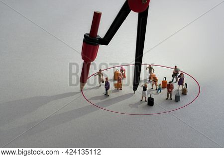 Compass With Red Pencil Circle Around Miniature Travellers With Luggage