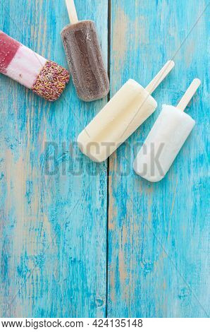 Frozen Ice Lollies On A Wooden Background
