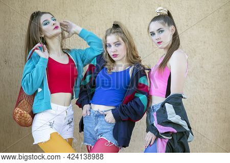 Three Pretty Girls Dressed In The Style Of The Nineties.