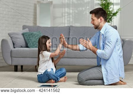 Little Child Plays With Daddy At Home