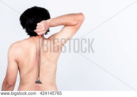 Back Of Man Using A Stick To Scratch The Back Help Scratch The Skin Itching Area From Dermatitis, On
