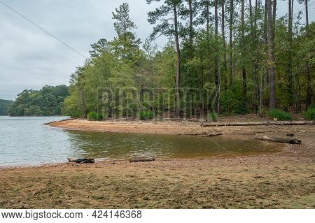 Severe Drought Levels At Lake Lanier In Georgia With Layers Of Beach Exposed Where It Should Be Unde
