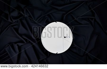 Robot Vacuum Cleaner On A Black Background. Modern Robot Vacuum Cleaner, Top View