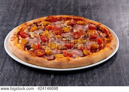 fresh pizza on the white plate