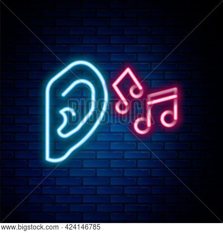 Glowing Neon Line Ear Listen Sound Signal Icon Isolated On Brick Wall Background. Ear Hearing. Color