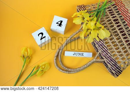 Calendar For June 24: Cubes With The Number 24, The Name Of The Month Of June In English, Yellow Iri