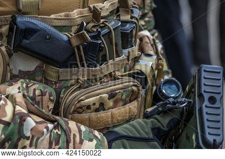 Pistol In Holster On Belt Of An Armed Man.multicam Camouflage. Topic: Weapon, Armed Man, Gun, Milita