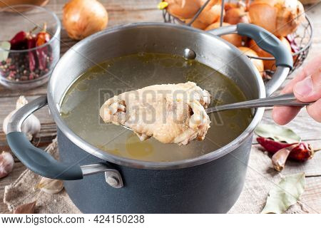Saucepan With Chicken Bouillon Or Bone Broth On The Wooden Table, Paleo Diet