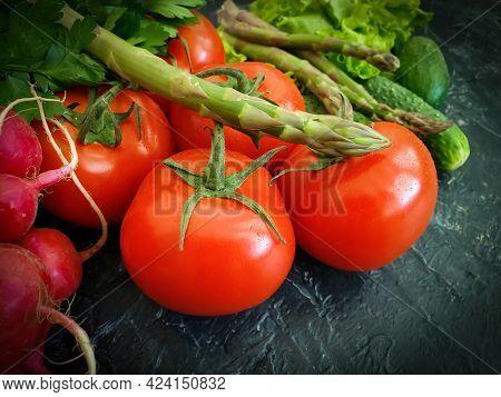 Fresh Vegetables, Tomato, Cucumber, Lettuce, Asparagus On A Concrete Background