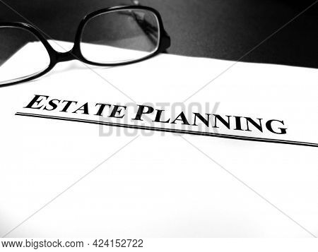 Estate planning documents on desk with glasses plan