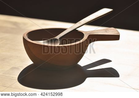 Wooden Bowl With Wooden Spoon On Wooden Table, Woodcraft For Kitchen Utensils.