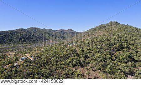 Cape Gloucester, Queensland, Australia - June 2021: Aerial View Of Homes Nestled Amongst Bushland On