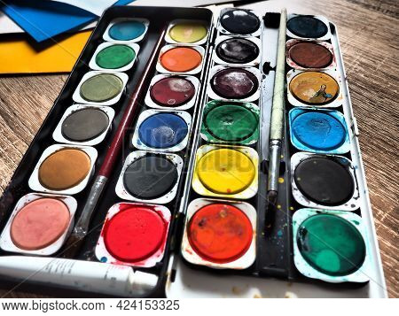 A Set Of Watercolors Of Different Colors For Drawing. Multicolored Round Containers With Bright Pain