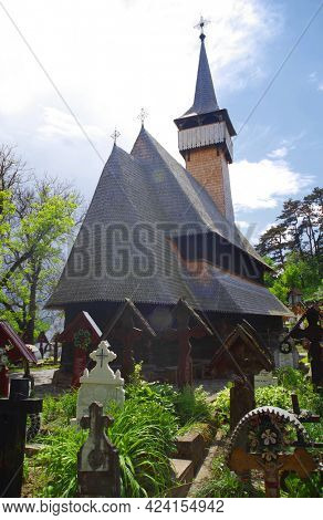 IEUD, ROMANIA, JUNE 09 2021 - Ieud Hill wooden monastery and its graveyard, the oldest wood church in Maramures, Romania, Europe - UNESCO Heritage