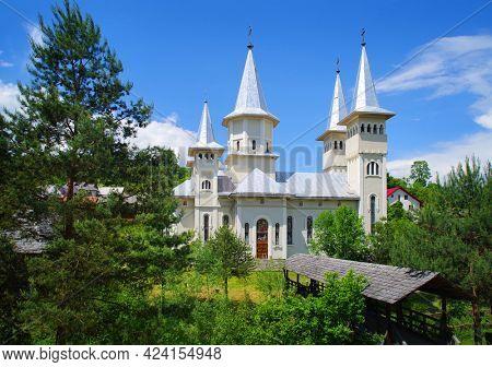 POIENILE IZEI, ROMANIA, 09 JUNE 2021 - Old church in Poienile Izei village, Maramures county, northern Romania, Europe
