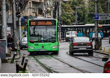 Bucharest, Romania - June 18, 2021: A Public Transport Bus Mercedes Citaro Hybrid Is Driven In Traff