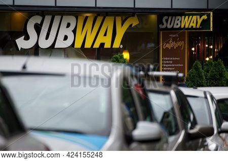 Bucharest, Romania - June 18, 2021: The Logo Of A Subway Fast Food Restaurant It Can Be Seen Above T