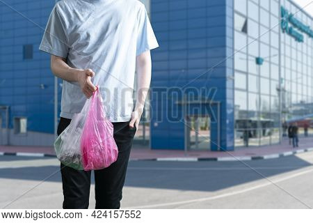 A Person Holding A Plastic Bag, Reused Recycling Concept