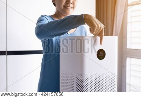 Woman Hands Using White Modern Air Purifier In A Living Room For Refresh Air Flow At Home,advanced A