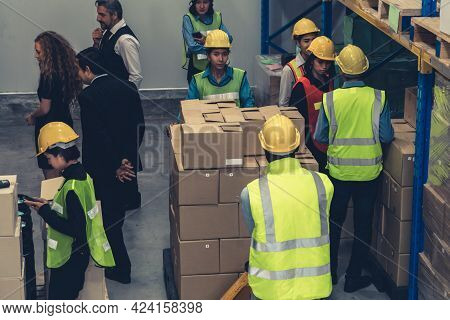 Many People , Workers And Manger Work In Warehouse Or Storehouse . Logistics , Supply Chain And Ware