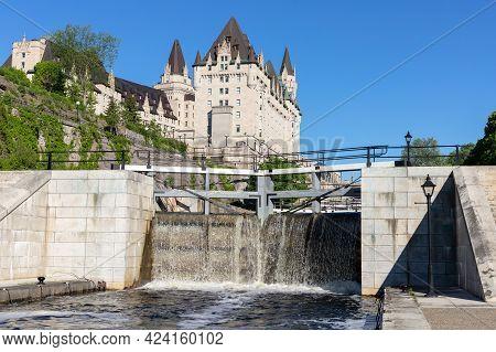Ottawa, Canada May 23, 2021: Rideau Canal Locks And Luxury Fairmont Chateau Laurier Hotel In Ottawa,