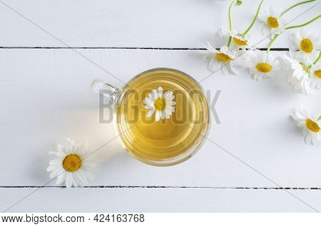 Close-up Top View Of A Cup Of Chamomile Tea. Alternative And Traditional Medicine. Herbal Treatment.