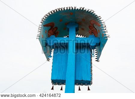 Crucifix Made Of Wood . Symbol Of Christianity . Wooden Cross Painted In Blue