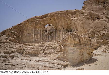 The Famous Arch Shaped Rock In The Timna Valley Park, The Negev Desert, Southern Israel.