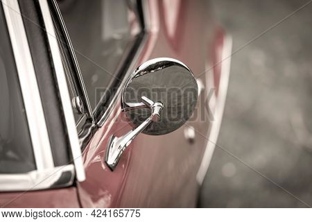 Close up shot of Vintage car side view mirror