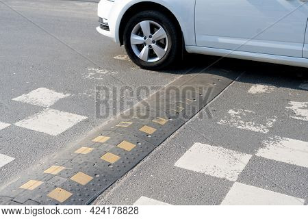 A Speed Bump On The City Road. Asphalt Barrier, Safety Obstacle