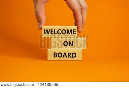 Welcome On Board Symbol. Wooden Blocks With Words 'welcome On Board'. Beautiful Orange Background, B