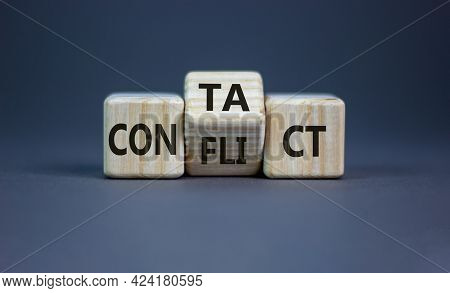 Conflict Or Contact Symbol. Turned The Wooden Cube And Changed The Word 'conflict' To 'contact'. Bea
