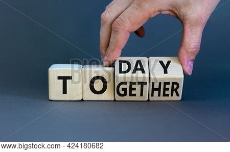 Today We Are Together Symbol. Businessman Turns Wooden Cubes And Changes The Word Together To Today.