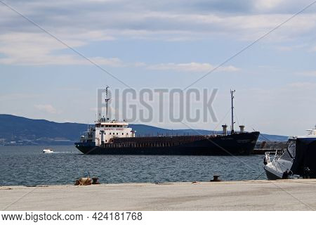 Stavros, Thessaloniki, Greece - June 14, 2013: View Of A Cargo Ship For Import - Export And Logistic