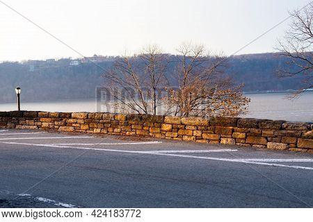 Stone Wall Along Roadside Against Hudson River, Upper Manhattan, New York