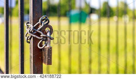 Metal Chain And Lock Hang On The Metal Door