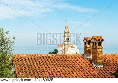Sunny Summer View Of St. Georges Parish Church In Piran Town. Beautiful Cityscape Of Slovenia, Europ