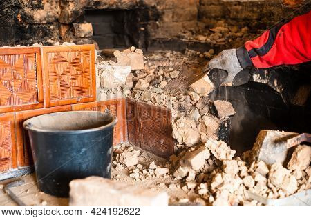 An Old Brick Stove, Brick In Soot, Dismantling The Old Kitchen With His Hands, The Master Rolls Off