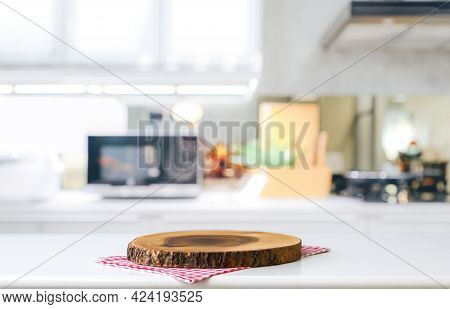 Empty Cutting Board On A Wooden Table And Blurred Kitchen Background
