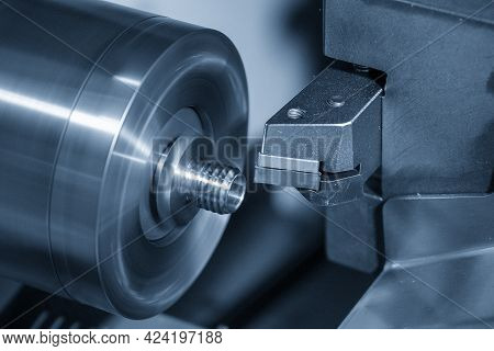 The  Cnc Lathe Machine Thread Cutting The Metal Shaft Parts. The Hi-technology Metal Working Process