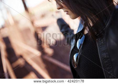 Young anonymous woman portrait, rocker wearing.