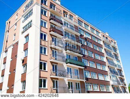 Apartment Building Against Blue Sky. Close Up.