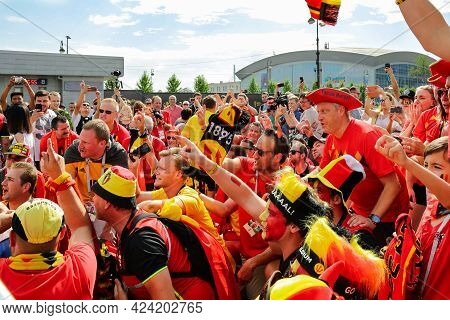 St. Petersburg, Russia - July 14, 2018: Emotional Group Of Belgian Soccer Spectators In T-shirts, Ki