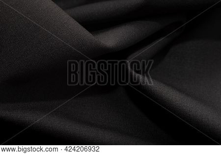 Cloth. Part Of The Dark Fabric Texture Of The Fabric For The Background And Decoration Of The Work O