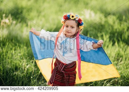 Ukraine's Independence Anniversary Day. Constitution Day. Ukrainian Child Girl In Embroidered Shirt
