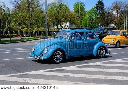 Bucharest, Romania, 24 April 2021 Old Retro Vivid Blue Turquoise Volkswagen Beetle Classic Car In Tr