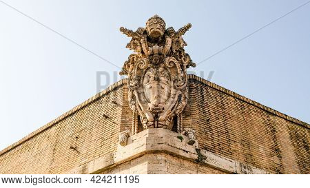 Vatican City. Vatican Coat Of Arms, At The Top Of One Of The Vatican Wall Corners.