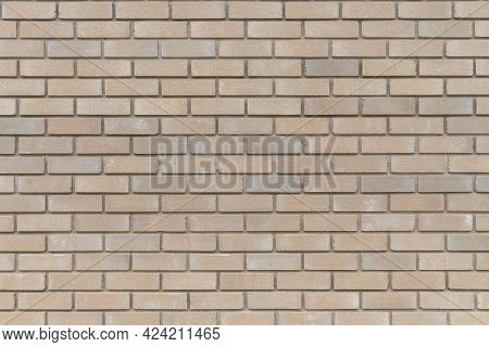 The Texture Of The Decorative Sand-colored Brickwork, Background.
