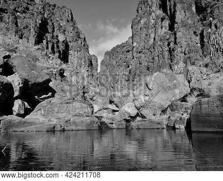 Ravine With Water In The Riverbed And High Cliffs, Barranco Hondo, Gran Canaria, Canary Islands