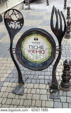 Lviv, Ukraine - April 05, 2011: Street Advertisement For One Of The Restaurants In The Center Of Lvi